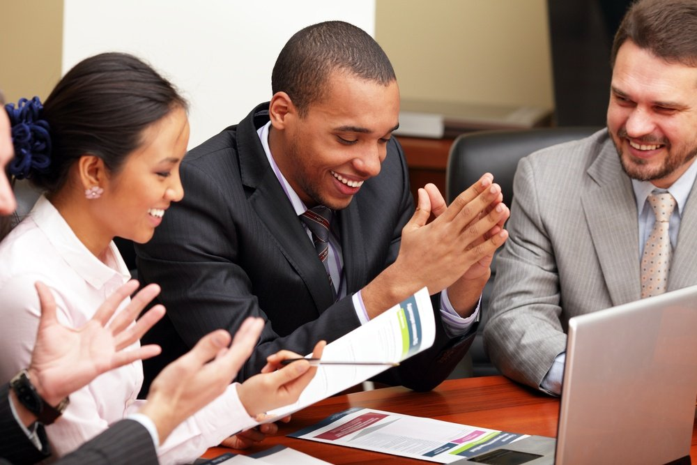 Multi ethnic business team at a meeting. Interacting. Focus on african-american man.jpeg